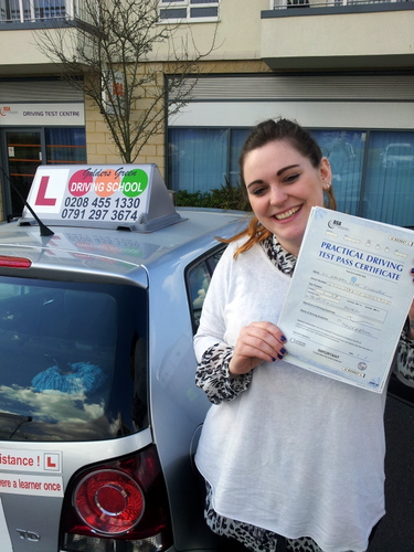 Happy candidate of Golders Green Driving School in London, after successfully passing her driving test
